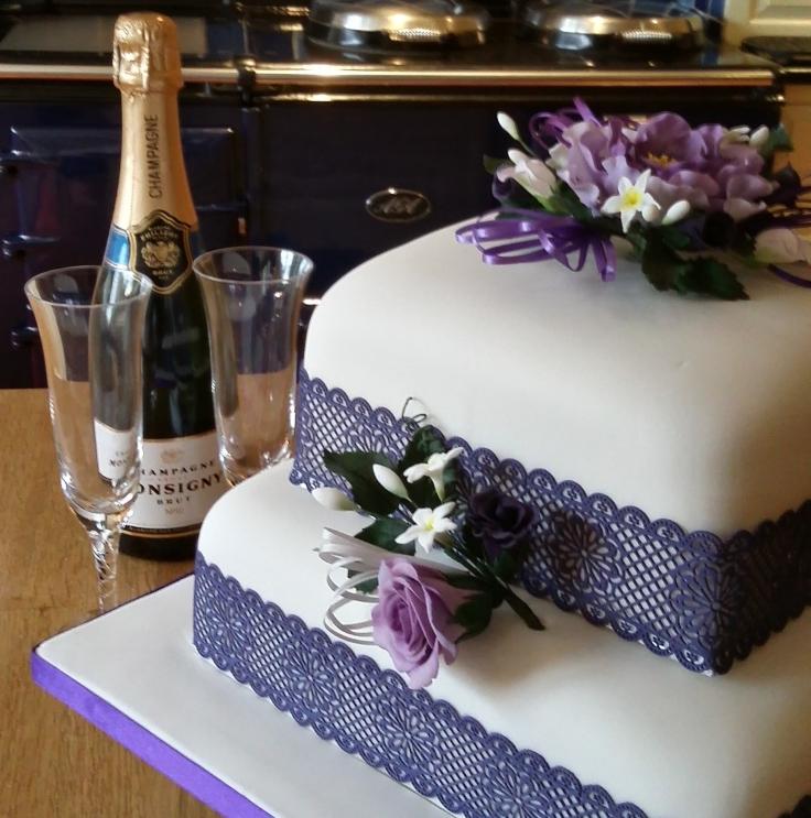 two-tier wedding cake: fruit and victoria sponge