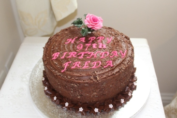 Rich chocolate cake with sugar rose