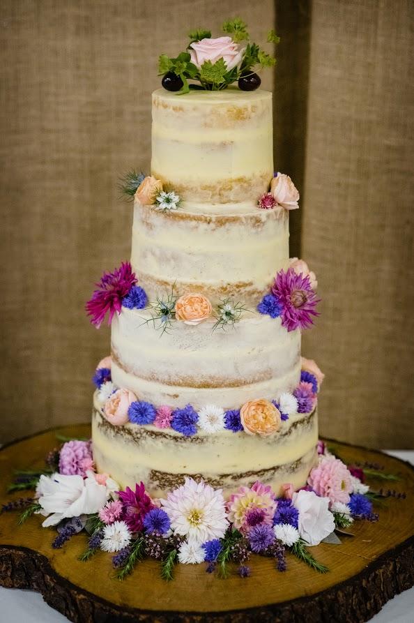 Semi-naked wedding cake: carrot, lemon & elderflower, white chocolate & raspberry, victoria sponge