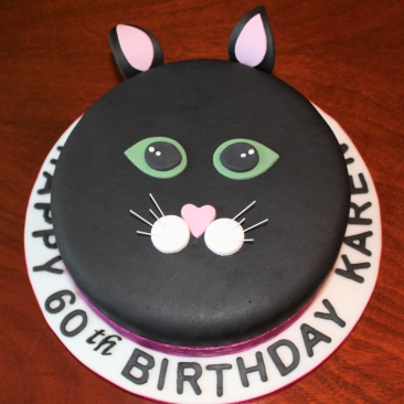 Cat-themed victoria sponge cake