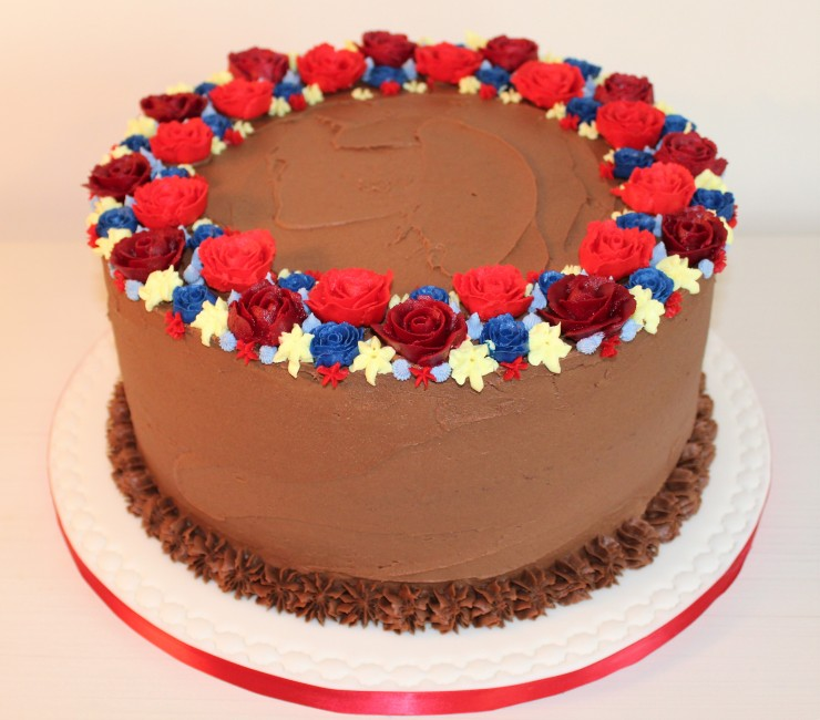 Rich chocolate cake with buttercream flowers